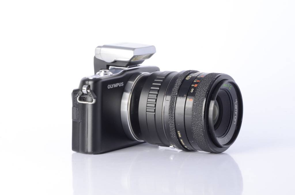 olympus olympus pen mini e pm1 micro 4 3 camera with the olympus fl rh lezotcameras com Olympus E-PM1 Review Olympus E- PL1 Lenses