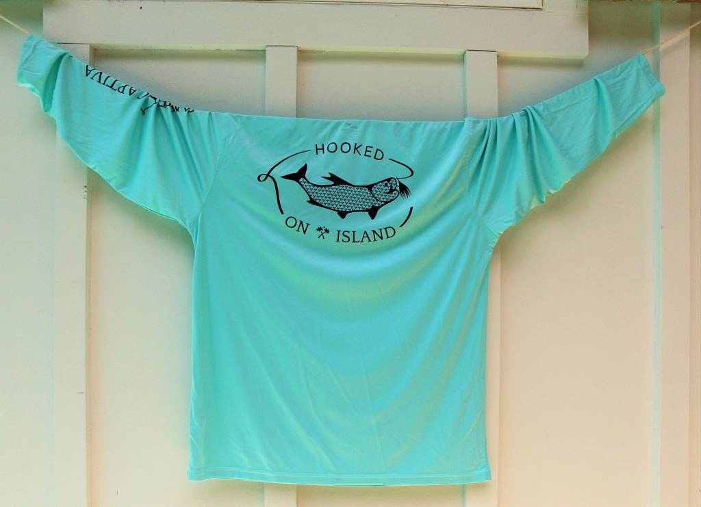 Hooked spf performance fishing shirt in mint green on island for Spf shirts for fishing
