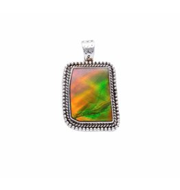 Natural Iniskim Silver Pendant by Ruth Ann Begay (Navajo).