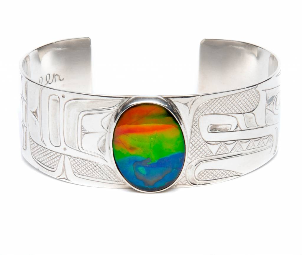 "Silver and Ammolite 1"" Wolf Bracelet by Henry Green (Tsimshian)."