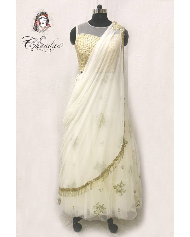 Cream lehenga choli with embroidery and sippy work