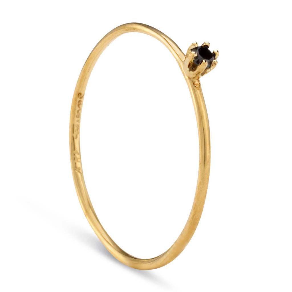 satomi kawakita jewelry tiny black diamond solitaire ring