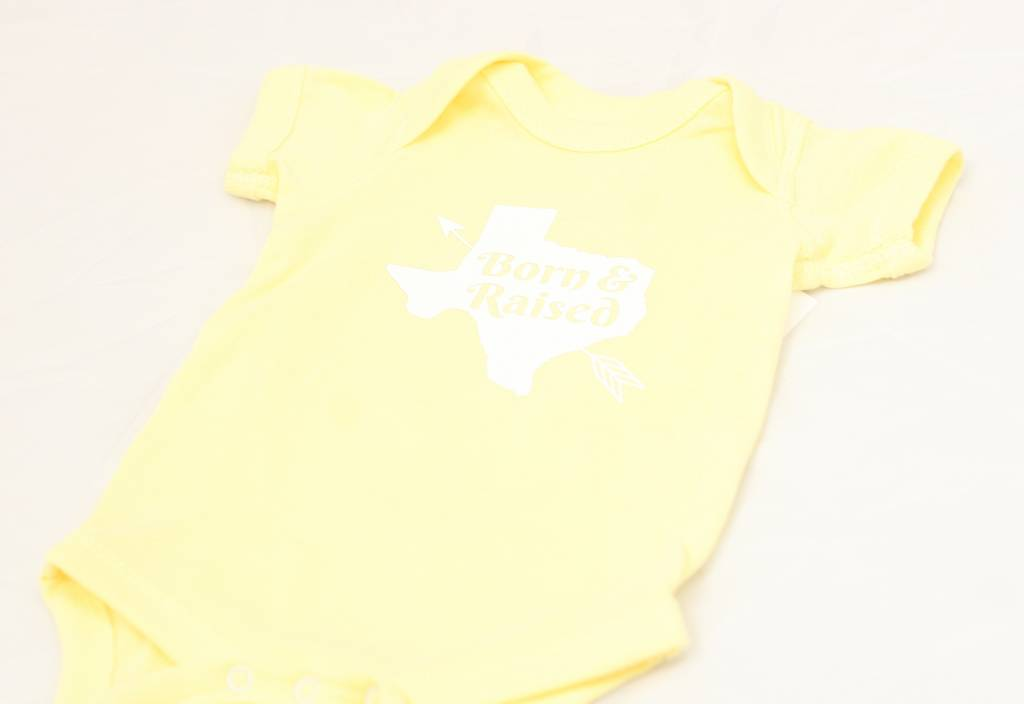 Nappy Shoppe Exclusives Onesie - Born and Raised