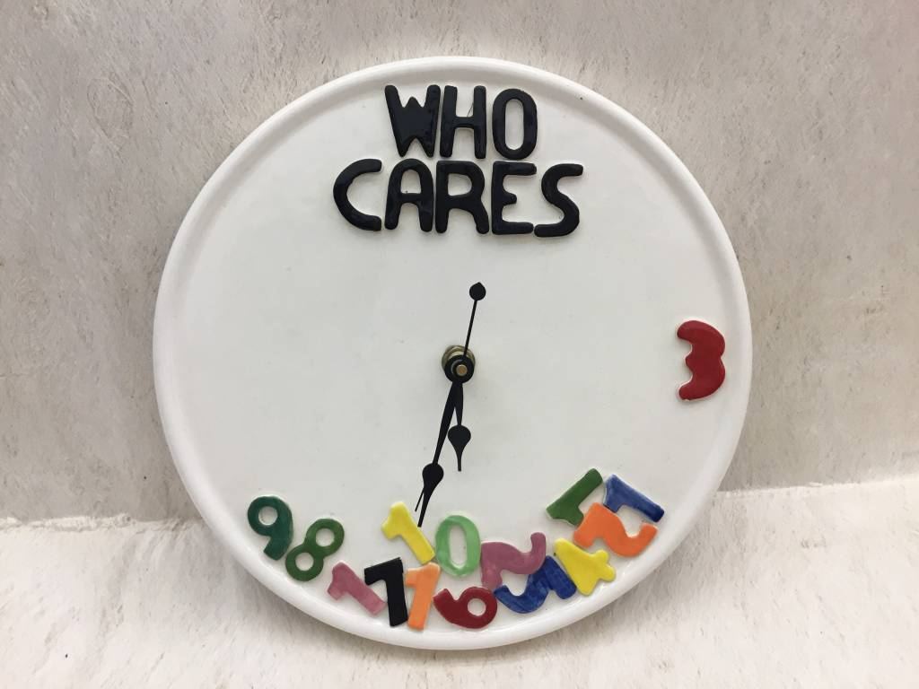 "Who Cares"" Wall Clock"