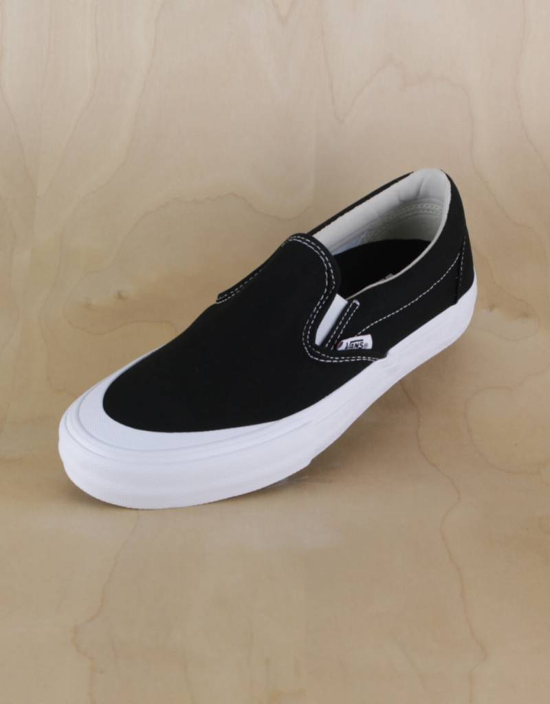 vans black and white slip ons