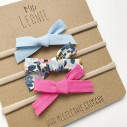 Mlle Léonie Mlle Léonie - Trio de Bandeaux  Boucles Nouées/Headbands Knotted Buckles Trio, Bleu Pâle, Fleur Bleue, Rose Vif/ Light Blue, Blue Flower, Bright Pink