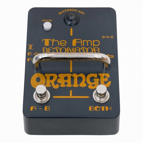 Orange Amp-Detonator Buffered active ABY switcher, custom isolating transformer, polarity switch, tri-color LED, 9v