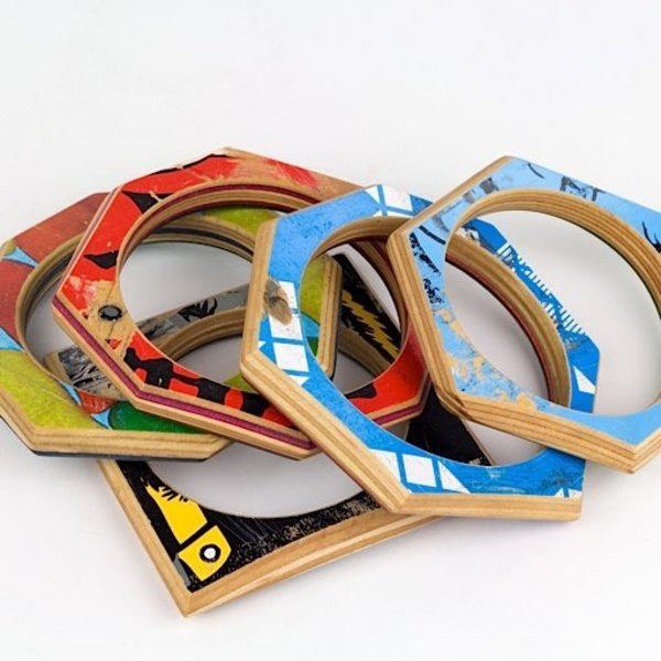 Tara Locklear Tara Locklear, Gem Bangle, broken skateboards, pigment. 3.75 x 4 x .25 in