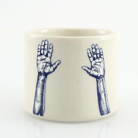 "The Democratic Cup, Hands Up Cup, image by Shannon Tovey cup designed by Bianka Groves, porcelain 2 7/8"" x 4 1/4"" x 3 3/8"", 10 fl oz"