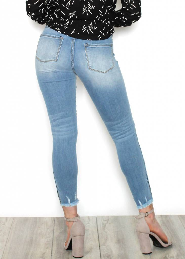 PORTIA LIGHT WASH SKINNY JEANS