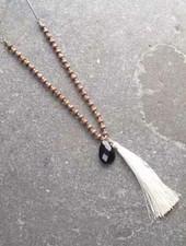 Long Wood-like beaded tassel necklace