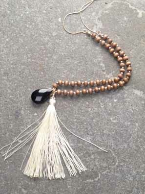 Long Wood-like beaded tassel necklace