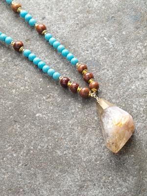 Long Turquoise beaded crystal rock pendant