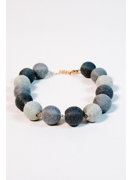 Trend Shades of grey thread ball necklace