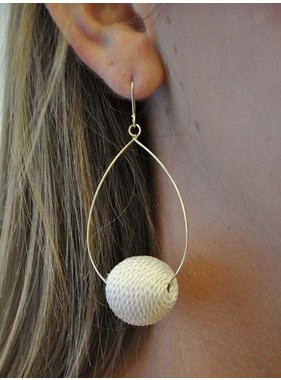 Ann Paige Designs oval dangle earring with pom pom accent