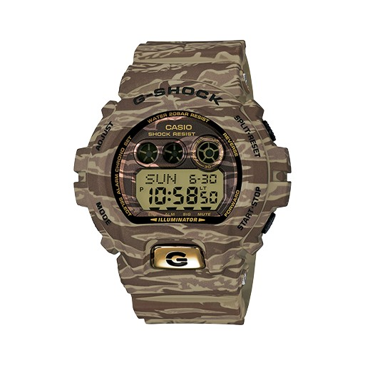 G-Shock Based on the success of the GDX6900CM tiger camouflage series this summer, G-SHOCK only made a minor change to its aesthetic for this 2nd edition. By adding a metal front button, these new models now have an additional bit of eye-catching pop. For those w
