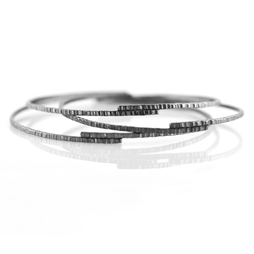 manipulated flat one bangles handmade with two at slightly a is an jump jewellery hammered the stella of biggish sits silver bracelets so teaserbox linked it stokes ring