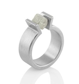 upright prong tension-set raw diamond . ring
