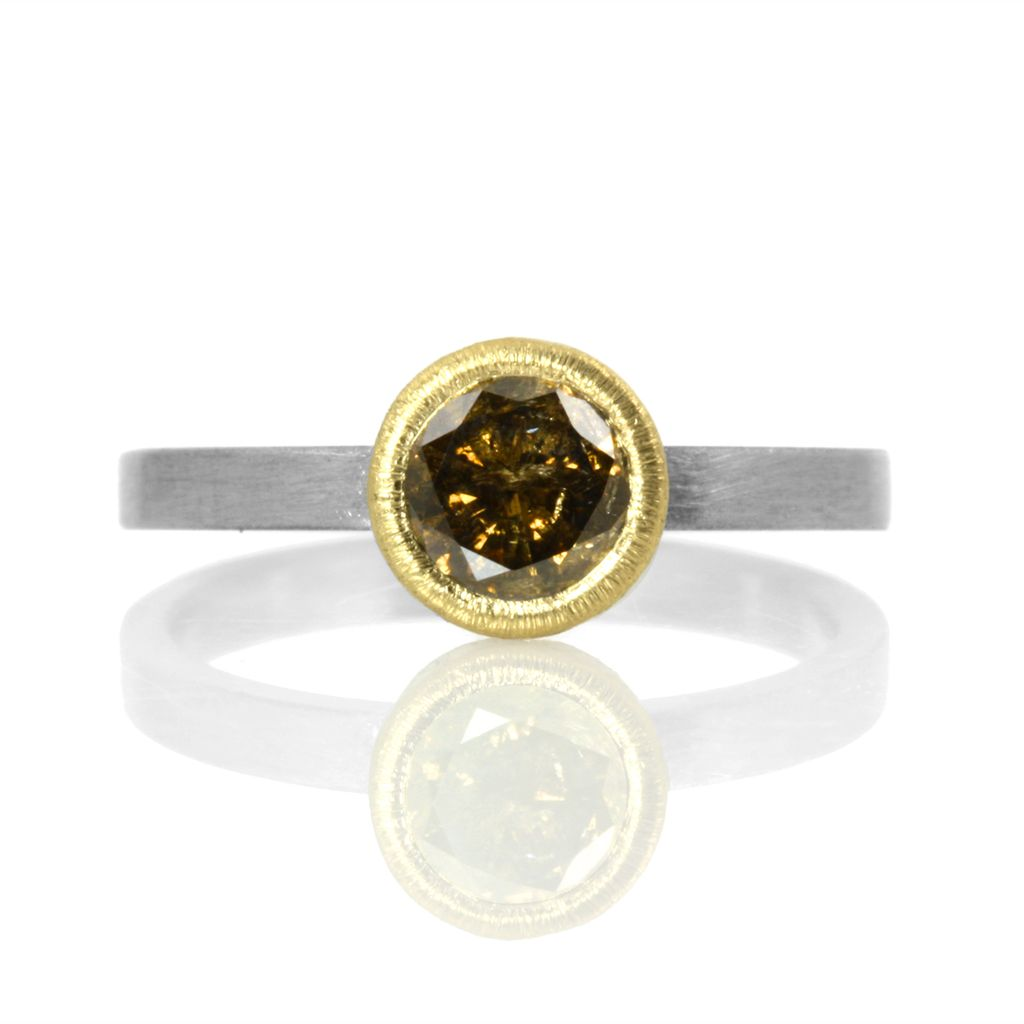 .7ct chocolate diamond in gold bezel-set solitaire . ring