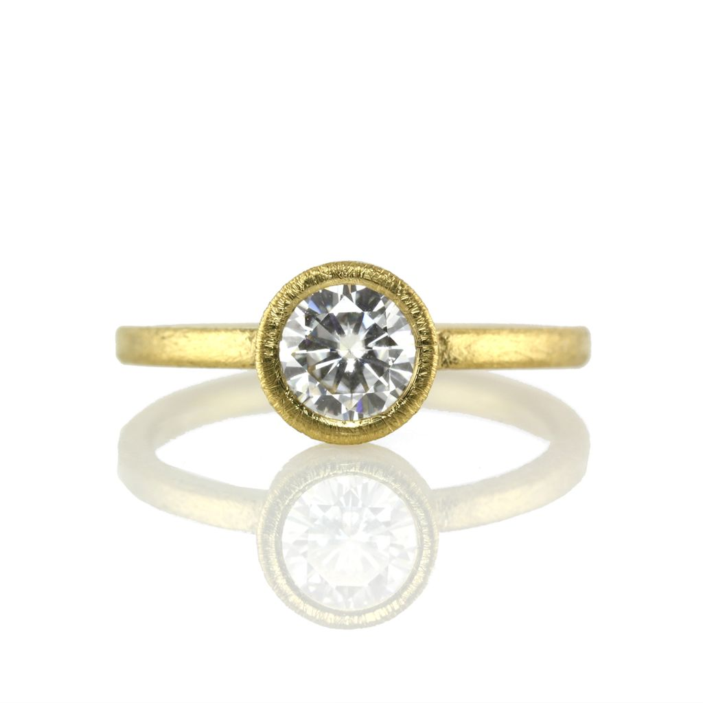 the gold solitaire w/ 6mm Moissanite . ring (sz: 7)