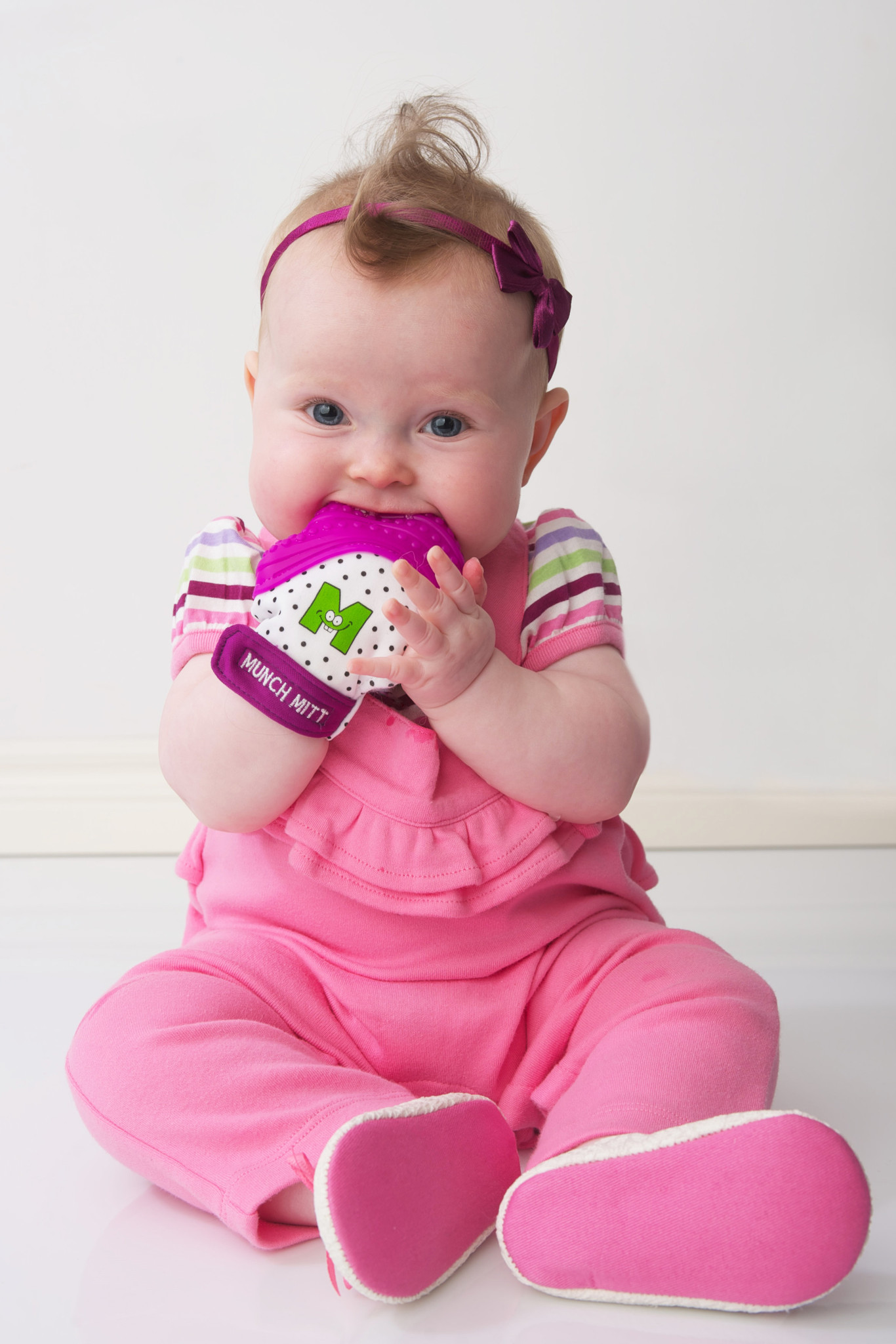 Munch Mitt Teether in Pink