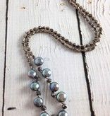 Handmade Silver Necklace with 9 top drilled peacock pearls, oxidized faceted silver knotted on grey