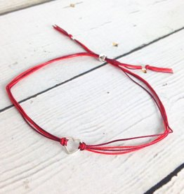 Sterling silver, small open heart bracelet on red nylon cord, adjustable closure