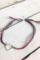 Sterling silver medium open heart bracelet on rainbow silk cord, adjustable closure