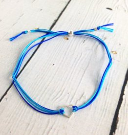 Sterling silver, small open heart bracelet on blue nylon cord, adjustable closure