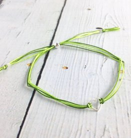 Sterling silver, small open heart bracelet on green nylon cord, adjustable closure