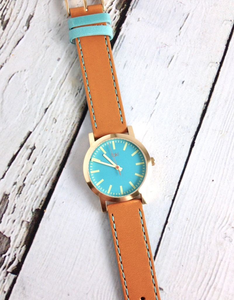 Eden Watch, Ocean Blue Face and Saddle Band with a Gold-tone Bezel