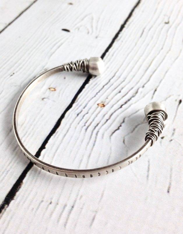 Handmade Etched sterling open cuff with bezel set white freshwater pearl end caps with wrap