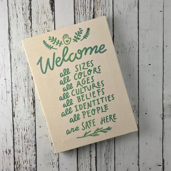 """Handprinted """"Welcome All"""" Canvas Wall Art"""