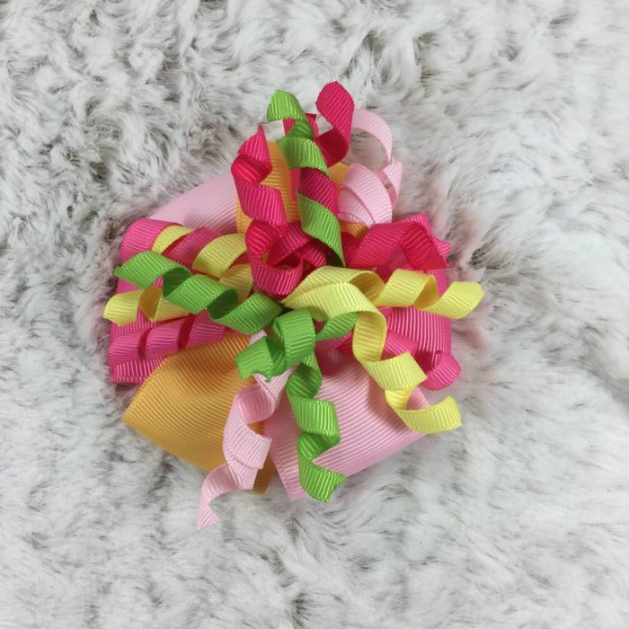 Multi Colored Bow on Pink Clip