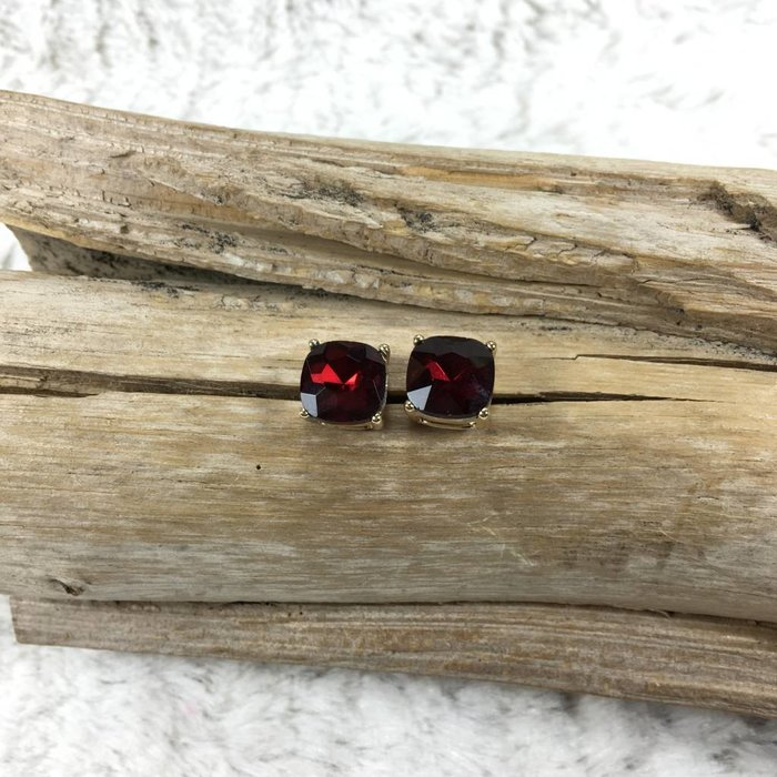 Red Stud Earrings on Gold Rim