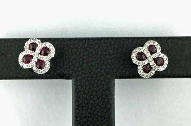 14kw .60ctw Ruby & .26ctw Dia Clover Design Earrings