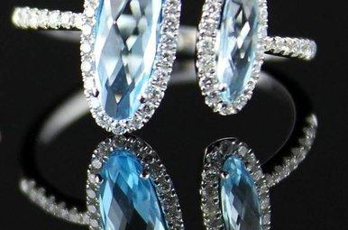 14kw .29ctw Dia 1.70ct Blue Topaz Fashion Ring