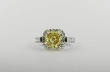 14KW 2.29CT NAT YW I1 GIA 3.81CTW HALO ENGAGEMENT RING WITH NATURAL YELLOW CENTER & 1.52CTW ROUND BRILLIANTS & PRINCESS CUTS