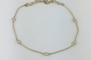 14k Yellow Gold .18ctw Diamond Bezel Station Adjustable Bracelet 6-7""