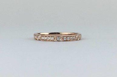 14k Rose Gold .19ctw Diamond Bezel Station Stackable Wedding Band (Size 6)
