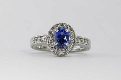 PLAT 1/3CTW-DIA 1CT-SA OVAL HALO BLUE SAPPHIRE & DIAMOND RING