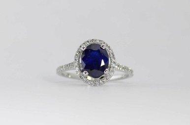 14KW .32CTW-DIA 2.46CT-SA OVAL HALO BLUE SAPPHIRE & DIAMOND RING