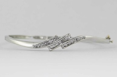 14KW 1/2CW LADIES BANGLE BRACELET WITH ROUND BRILLIANT & BAGUETTE DIAMONDS