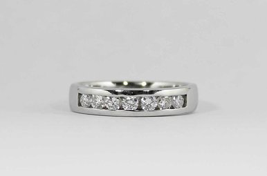 PLAT .84CTW GENTS CHANNEL WEDDING BAND WITH ROUND BRILLIANT DIAMONDS