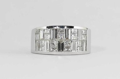 18KW 2.75CTW LADIES WIDE BAND WITH INVISIBLY SET PRINCESS CUT & BAGUETTE DIAMONDS