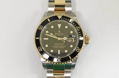 18KY/STAINLESS PREOWNED GENTS ROLEX SUBMARINER WITH BLACK BEZEL & DIAL