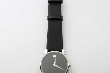 STAINLESS PREOWNED MOVADO WATCH WITH BLACK LEATHER BAND