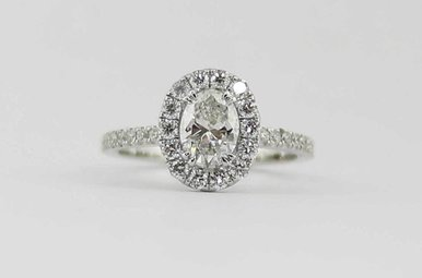 14KW .75CT-CTR 1.27CTW HALO DIAMOND ENGAGEMENT RING WITH OVAL CENTER