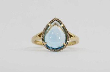 14KY .10CTW-DIA 4CT-BT CABOCHON BLUE TOPAZ & DIAMOND LADIES HALO RING