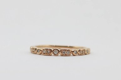 10K Rose Gold .10ctw Diamond Stackable Station Wedding Band
